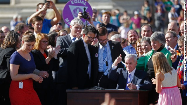 At the state Capitol in St. Paul, Minnesota, Gov. Mark Dayton signs a bill legalizing same-sex marriage in May 2013.