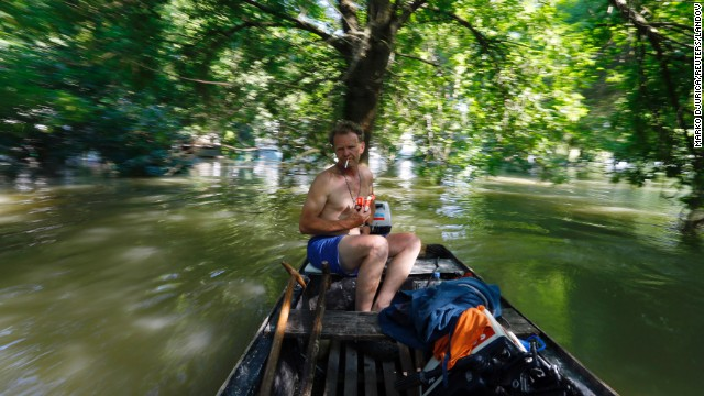A man drives a motorboat on floodwaters from the Danube River in Apatin, Serbia, on Thursday, June 13.