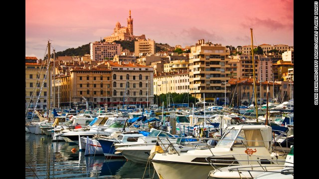 This year's European Capital of Culture, Marseille is also famous for its fresh seafood and as the home to bouillabaisse. The view here is of the Notre-Dame de la Garde from the Vieux Port (Old Port).