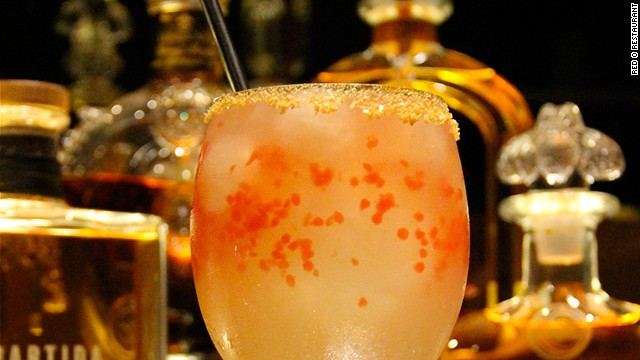 What makes this marg from Red O Restaurant in Los Angeles worth a C note? Three extra añejo tequilas and an edible-gold-and-kosher-salt rim!