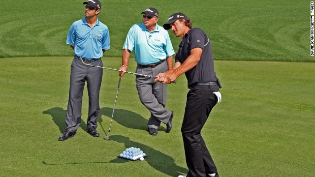 Harmon and his son Claude III working with Adam Scott in 2009. Four years later the Australian won his first major title at the Masters. The Harmons have also helped President Obama refine his swing.