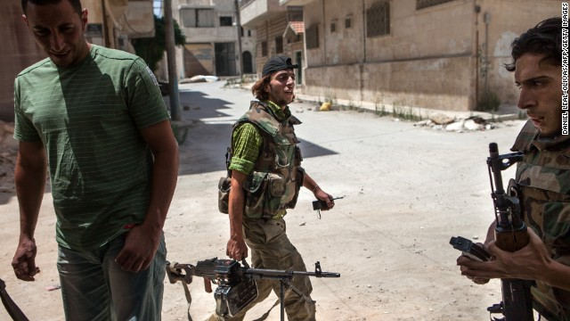 "Syrian rebels leave their position in the northwestern town of Maaret al-Numan on Thursday, June 13. The White House said that <a href='http://www.cnn.com/2013/06/13/politics/syria-us-chemical-weapons/index.html'>the Syrian government has crossed a ""red line""</a> with its use of chemical weapons and announced it would start arming the rebels."