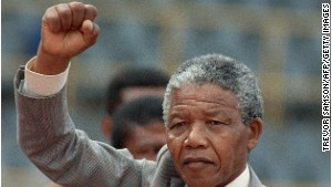 Nelson Mandela prepares to address a rally just a few days after he was released from prison, in February 1990. \n