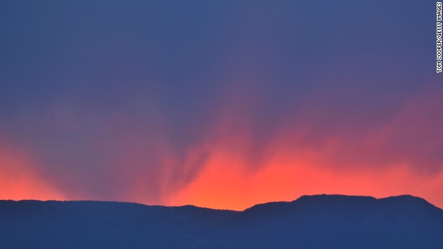 An orange sky highlights a fire on Thursday, June 13, that has been burning since June 11 near Colorado Springs.