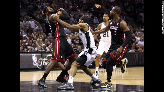 LeBron James of the Heat defends the ball against Kawhi Leonard.