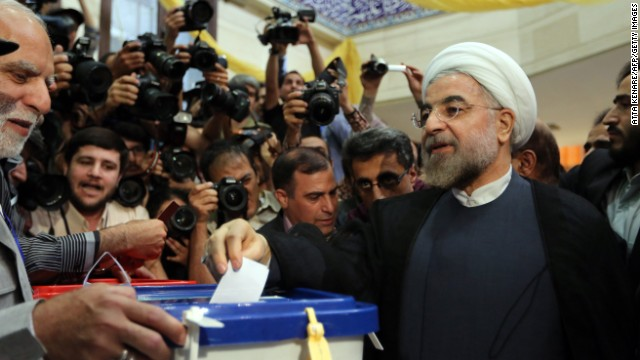 Presidential candidate Hassan Rouhani casts his vote in Tehran on June 14.