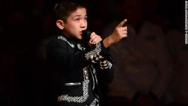 Opinion: The mariachi singer is more American than his critics