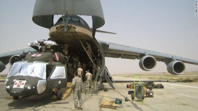 The C-5, seen here in Afghanistan, moves entire units of fighting forces and their battle machines such as helicopters, trucks and tanks around the world at jet speeds around 518 mph. Its nose opens the full width and height of the cargo bay for quick, easy loading.