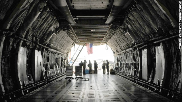 The C-5's cargo hold reaches 13.5 feet high. Its length stretches 143 feet, nine inches -- about 23 feet longer than the length of the first flight by the Wright brothers.