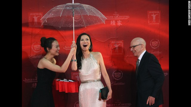 """I fell in love with her, and I asked her (to marry me). She said no, and it took a long time to persuade her,"" he told CCTV's ""Dialogue"" in 2011. Above, Murdoch and Deng at the Shanghai International Film Festival on June 11, 2011."