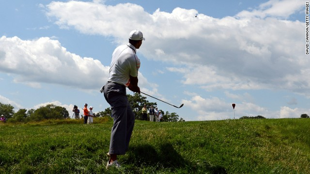 Tiger Woods of the United States hits a chip shot on the eighth hole during round two.