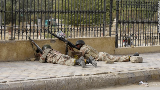 Soldiers take position near the hospital.