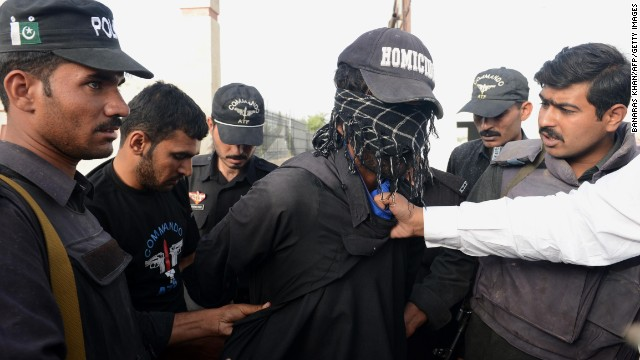 Pakistani soldiers arrest a suspected militant at the hospital. Among the patients at the complex were people wounded in a bus bombing near Sardar Bahadur Khan Women University that killed 12 female students.