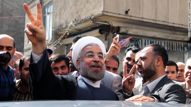 Rouhani leaves a polling station after voting in Tehran on Friday, June 14. About 50 million Iranian voters were eligible to go to the polls to select a new president from a field of six candidates.