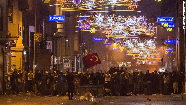 Protesters gather in the main shopping street near Taksim Square in the early morning hours of June 16 as riot police clear Gezi Park in Istanbul.