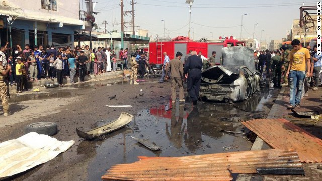 Iraqis gather at the scene of an explosion in Nasiriyah, south of the Iraqi capital Baghdad on June 16, 2013.
