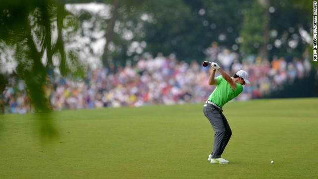 Rory McIlroy hits his second shot on the second hole.