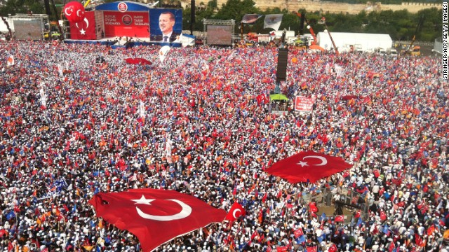 Tens of thousands attend a rally to hear Turkish Prime Minister Recep Tayyip Erdogan speak in Istanbul on June 16, a day after he ordered a crackdown on anti-government protesters at Gezi Park.