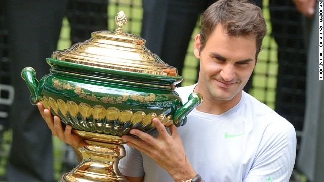 Swiss tennis star Roger Federer has now held the winner's trophy six times at the grass-court event in Halle, Germany.