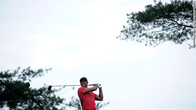 Tiger Woods hits from the 5th tee during the fourth round on June 16.