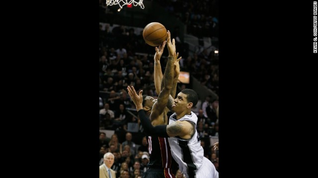 Danny Green of the San Antonio Spurs goes up for a shot against Udonis Haslem of the Miami Heat.