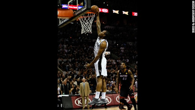 Kawhi Leonard of the San Antonio Spurs dunks.