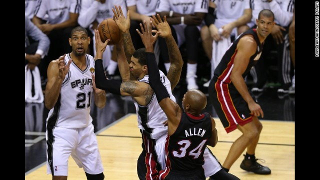 Danny Green of the San Antonio Spurs goes up for a shot against Ray Allen of the Miami Heat in the second quarter.