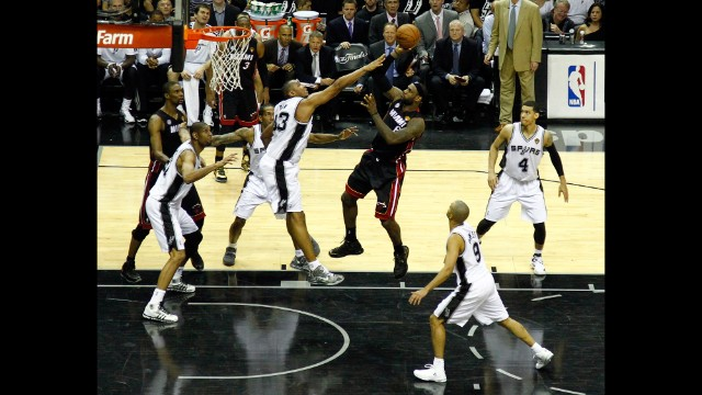 LeBron James of the Miami Heat shoots over Boris Diaw of the San Antonio Spurs. The Spurs won 114-104.