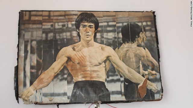 Kung Fu legend Bruce Lee surveys proceedings in the dusty martial arts gym in a Lucknow suburb.