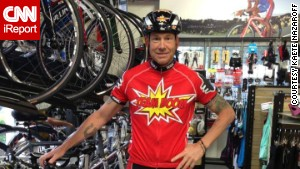 Dave Nazaroff in his bike shop in a \