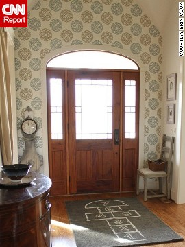An open floor plan and two adjacent formal rooms could have overwhelmed <a href='http://ireport.cnn.com/docs/DOC-988273'>Erin Cook</a>'s foyer in Charlotte, North Carolina, but she choose whimsical wallpaper and a hopscotch rug for a stand-out look.