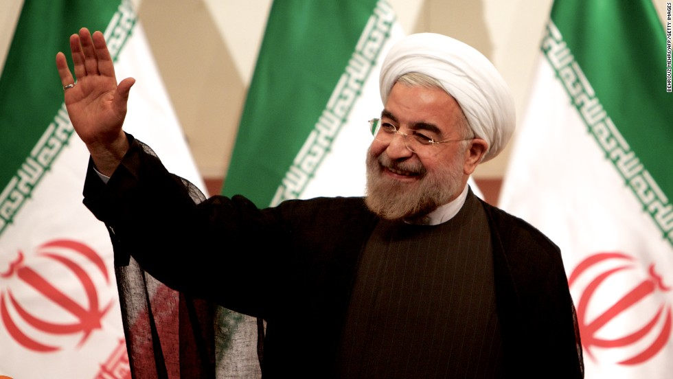 "Iranian President-elect Hassan Rouhani waves at a news conference in Tehran on Monday, June 17. Rouhani, a cleric and moderate politician, took more than 50% of the vote after campaigning on a platform of ""hope and prudence,"" appealing to both traditional conservatives and reform-minded voters."