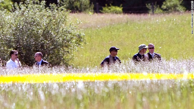 FBI agents search a field for Hoffa's remains on Monday, June 17, in Oakland Township, Michigan, outside Detroit. Alleged mobster Tony Zerilli tipped off the police, and a source close to the case said the information provided was