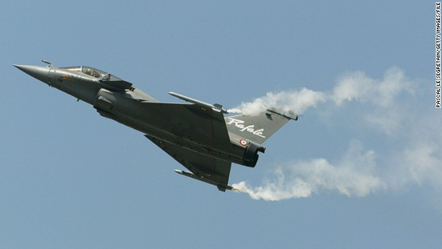 Aircraft fighter, Rafale, of Dassault Aviation company is seen during a flying display above Le Bourget airfield on the opening day of the Paris airshow in 2003.