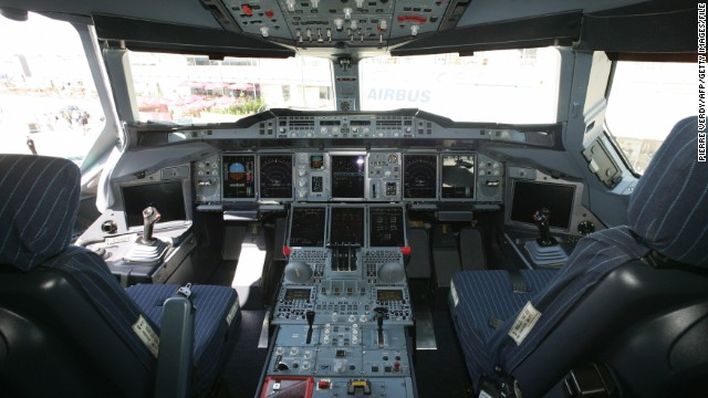 Inside the cockpit of the Airbus A380 at Le Bourget airport on June 12, 2005 after the plane landed near Paris. It became one of the star attractions of that year's show completing several aerial demonstrations above the airfield for visitors and buyers.