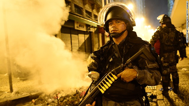 A riot police officer holds a weapon during clashes in Rio de Janeiro on June 17.