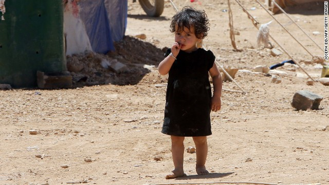 A child, whose family fled violence in Syria, stands at the Arsal refugee camp on June 14 in Lebanon's Bekaa Valley.