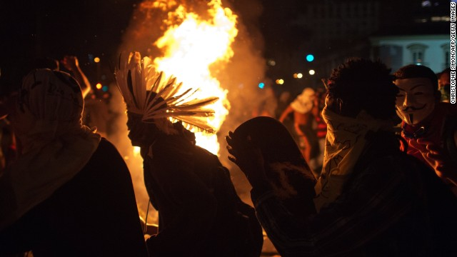 Protestors dance around a fire during clashes at the legislative parliament (ALERJ) in Rio de Janeiro's downtown on june 17, 2013.