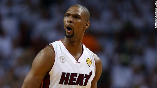 Chris Bosh of the Miami Heat reacts after scoring in the first quarter while taking on the San Antonio Spurs during Game 6.
