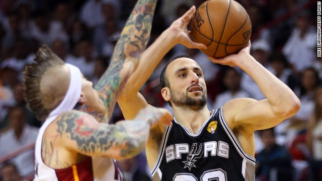 Manu Ginobili of the San Antonio Spurs shoots over Chris Andersen of the Miami Heat.