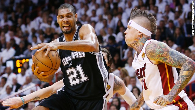 The San Antonio Spurs' Tim Duncan drives to the net on Miami Heat's Chris Andersen during Game 6.