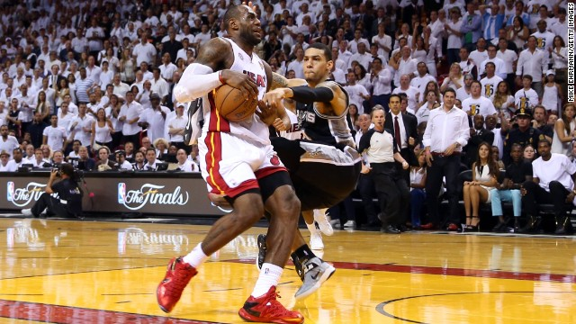 LeBron James of the Miami Heat goes up for a shot against Danny Green of the San Antonio Spurs in overtime during Game 6.