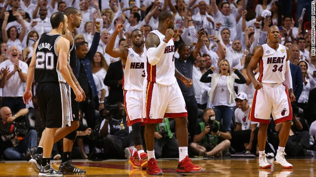 Dwyane Wade, back, LeBron James, center, and Ray Allen of the Miami Heat celebrate after defeating the San Antonio Spurs during Game 6 of the 2013 NBA Finals on Tuesday, June 18, in Miami. The Heat beat the Spurs 103-100 to tie the series 3-3. <a href='http://www.cnn.com/2013/06/16/us/gallery/nba-finals-game-5/index.html'>See photos from Game 5.</a>