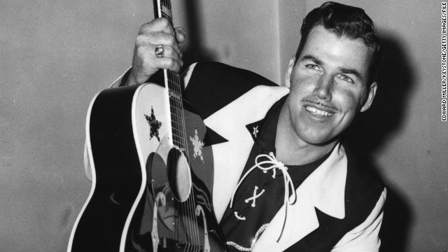 Country music singer/songwriter Slim Whitman died on June 19, his son-in-law Roy Beagle told CNN. He was 90. Above, Whitman poses with his guitar at a press conference at the Prince of Wales Theatre in London, on February 22, 1956.