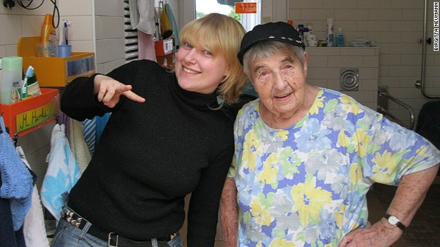 Resident Lydia Stehwin and personal care assistant Anica Szücs enjoy each other's company.