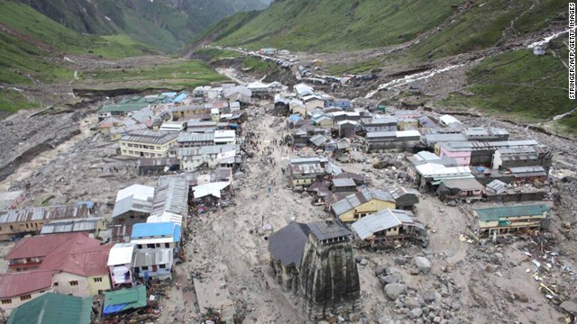 The Kedarnath Temple (C, foreground) is pictured amid flood destruction in the holy Hindu town of Kedarnath in Uttarakhand state on June 18.