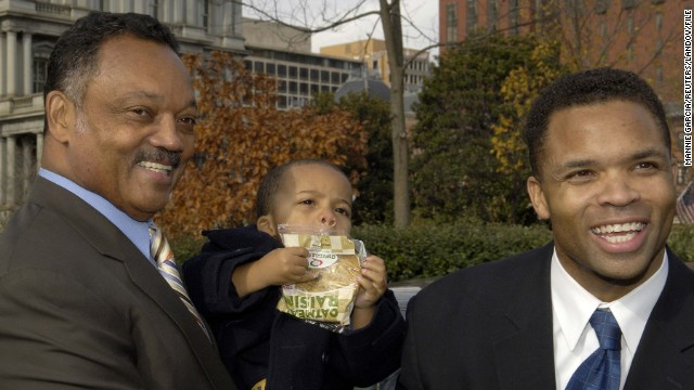 Leaving a White House ceremony in December 2005 are Jesse Jackson Jr., right, and the Rev. Jesse Jackson Sr., who's holding his grandson, Jesse Jackson III.