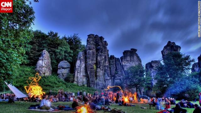 In Germany, the distinctive 'Externsteine' rock formation is an important venue for large festivals during the longest day of the year, similar to the UK celebrations at Stonehenge. Bernd Mestermann, who took this photo, has been going to this German event for 20 years.