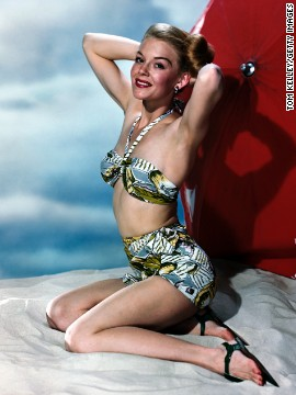 In the pin-up style, like the famous image of Betty Grable in a bathing suit from 1943, bathing suits were modeled in come-hither poses.