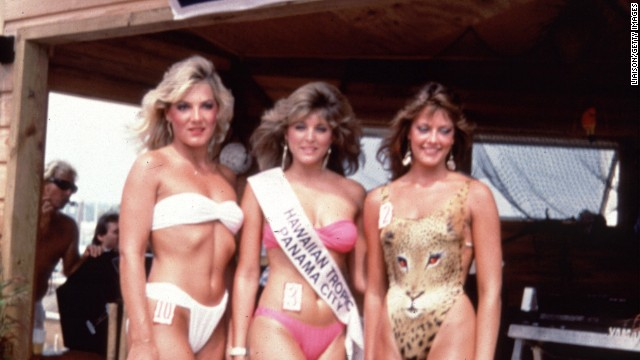 The Hawaiian Tropic bikini pageants of the 1980s featured models in skimpy, high-cut bikinis and swimsuits, which showed off the sun-worshiping, tanning culture of the time. Marla Maples, pictured here in the center, was a Hawaiian Tropic beauty queen before becoming Mrs. Donald Trump.